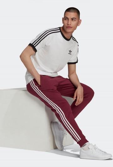 Pantalones adidas ADICOLOR CLASSICS 3 BANDAS burdeos
