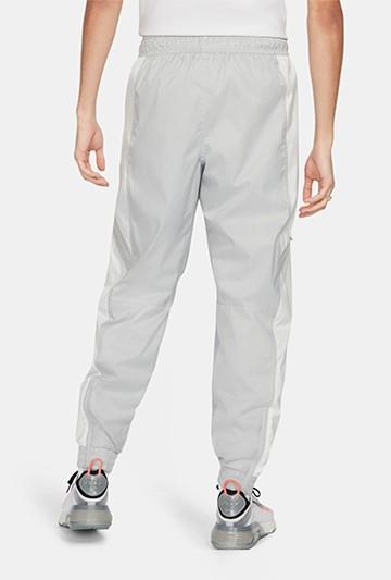 Pantalón Nike Air Woven gris